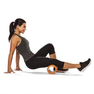 Image depicting a woman using a Foam Roller