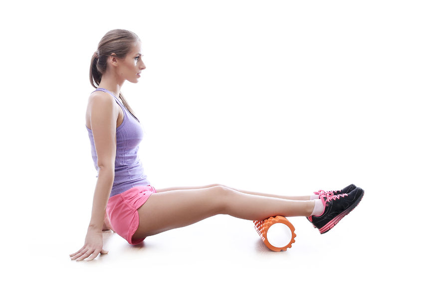 Image depicting a woman Foam Rolling Calf Muscles