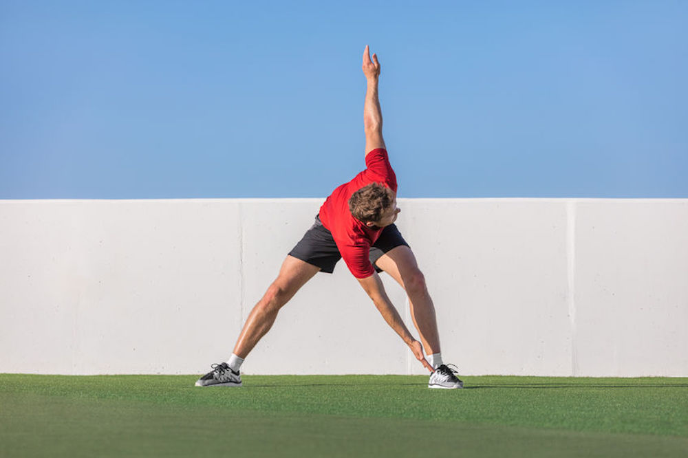 Image of a man performing Dynamic stretching