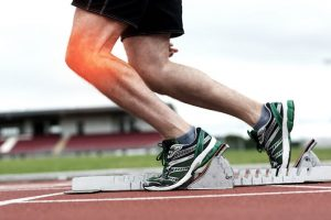 Image of a man running with Knee Pain