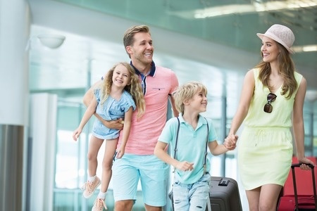 Family at airport leaving for holiday - Naturopaths guide to a healthy holiday