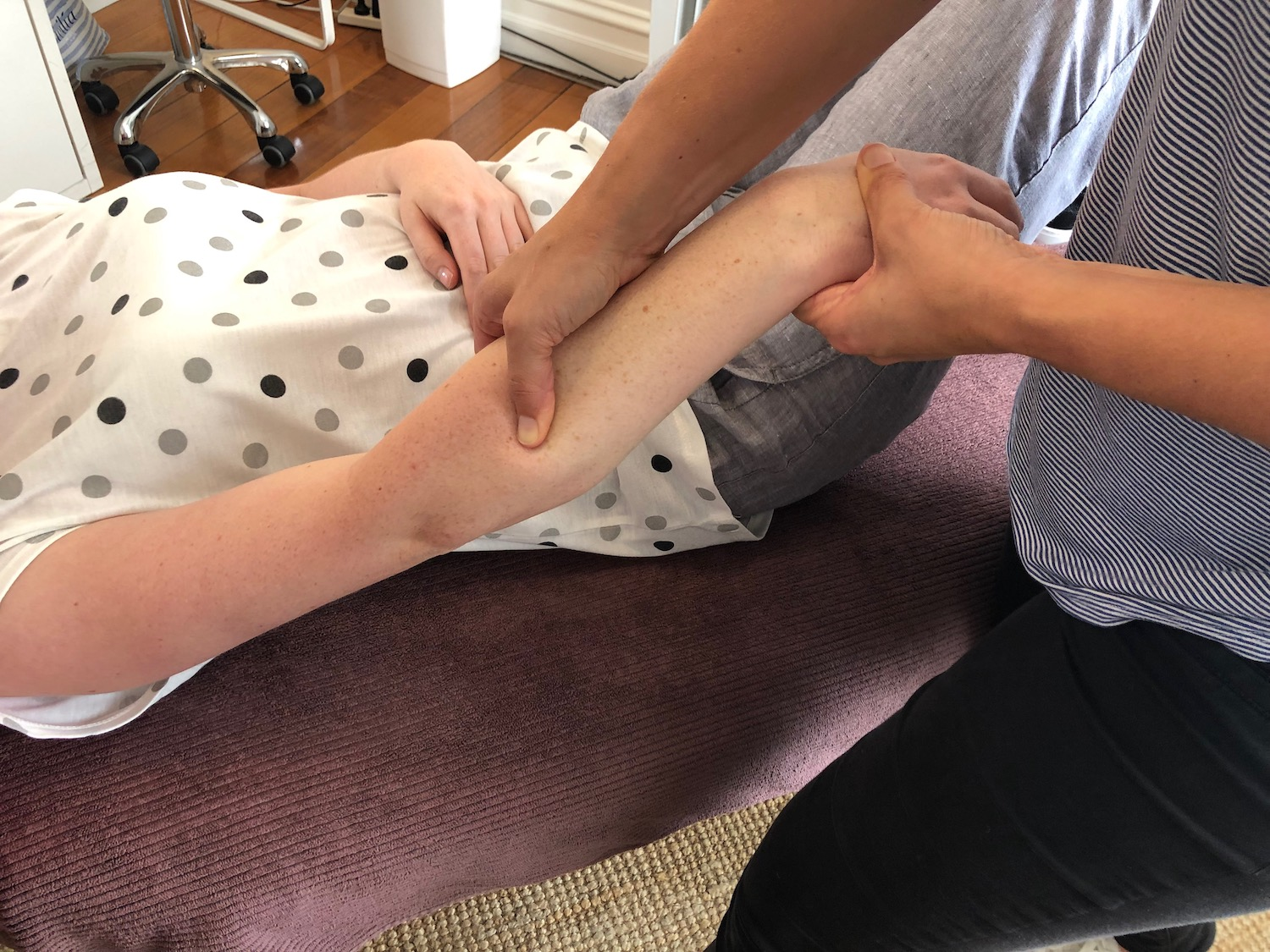 Image depicting a practitioner performing a Myofascial Release