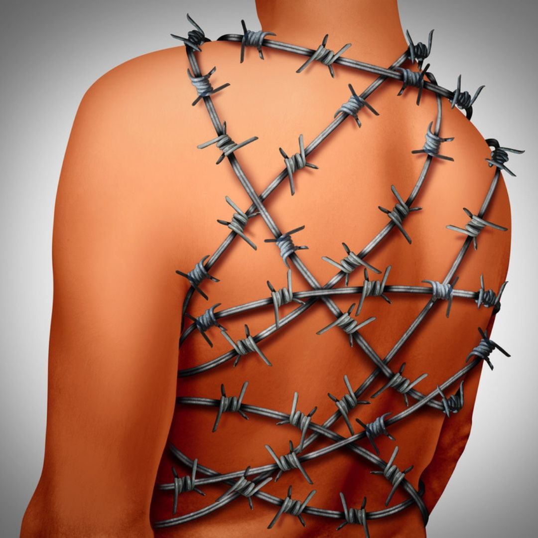 Image of a woman in chains depicting chronic pain