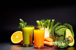 Image of fresh juice and food that provide a healthy liver