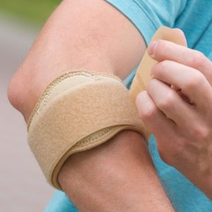 Image of an elbow strap associated with student's elbow
