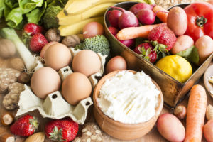 An image showing food that helps you to stay well