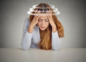 Image of a woman suffering from vertigo